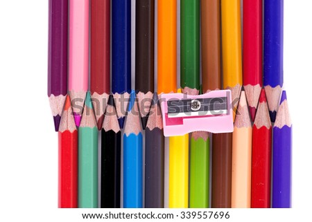Color pencils with sharpner isolated on white background close up