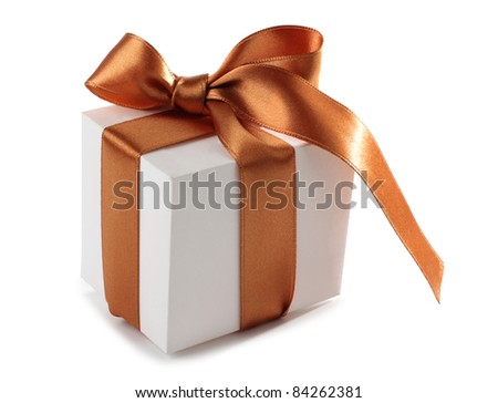 Color photo of a box and gold ribbon - stock photo