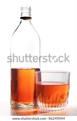 Color photo of a glass bottles of whiskey - stock photo