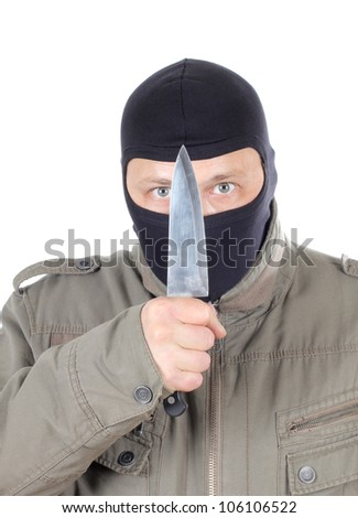 Color photo of a hooded man with a knife