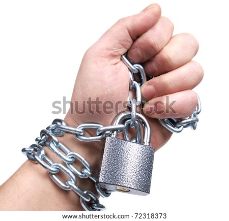 Color photo of a man's hand and a metal chain - stock photo