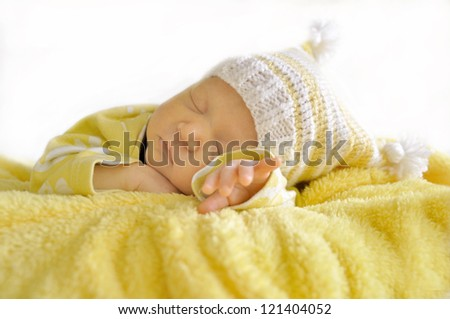 Color photo of a newborn baby sleeping peacefully - stock photo