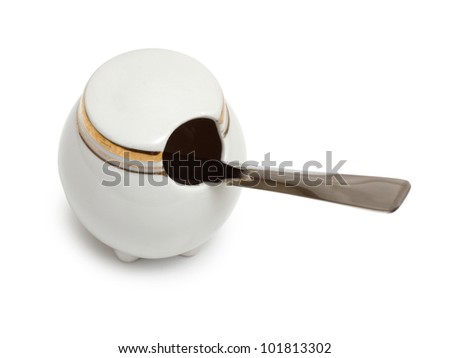 Color photo of a porcelain pepper with a spoon - stock photo