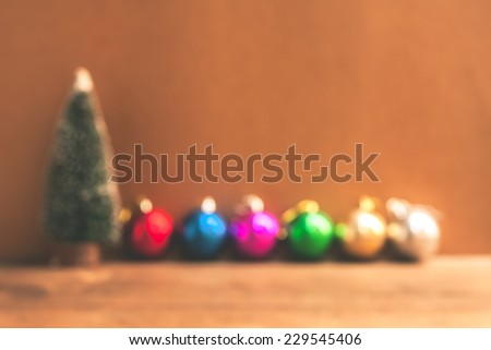 Color photo of blurred Christmas decorations on wooden background. abstract background to time for Christmas holiday.  - stock photo