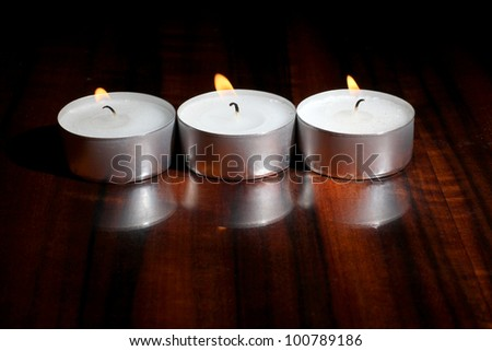 Color photo of candles on a wooden table - stock photo