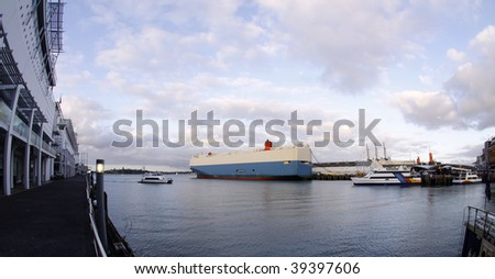 color photo of cargo ships, boats and ferry docked at Princes Wharf in Auckland,New Zealand viewed from a fish eye lens