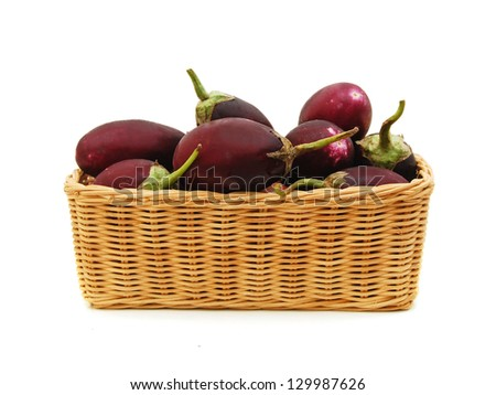Color photo of eggplant in basket on a white background