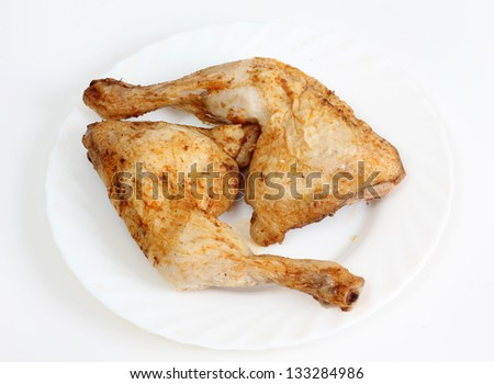 Color photo of fried chicken on a plate - stock photo