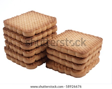 Color photo of stacks of square cookies on a white background