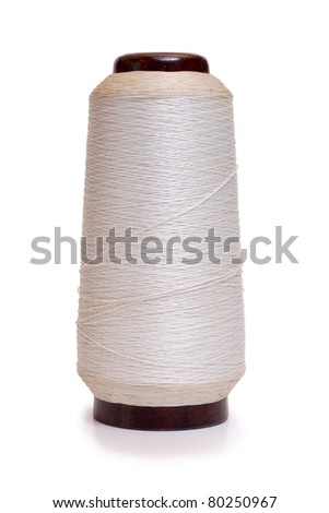 Color photo with white thread spools - stock photo