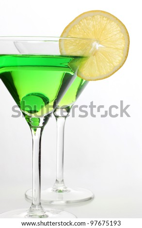Color photograph of glasses of wine and lemon