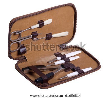 Color photograph of women's manicure set on a white background - stock photo