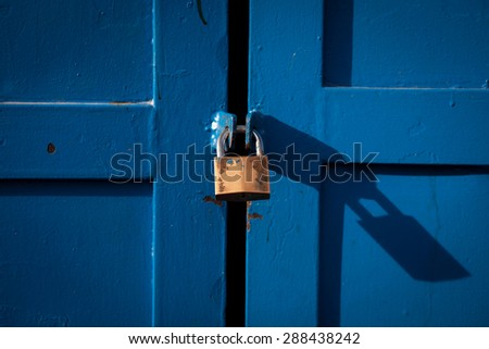 Color picture of a metal lock on a wooden door - stock photo