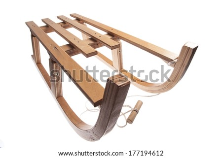 Color picture of a vintage wooden sledge isolated on white