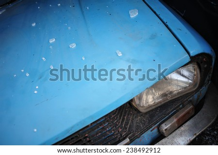 Color picture of an old car headlight - stock photo