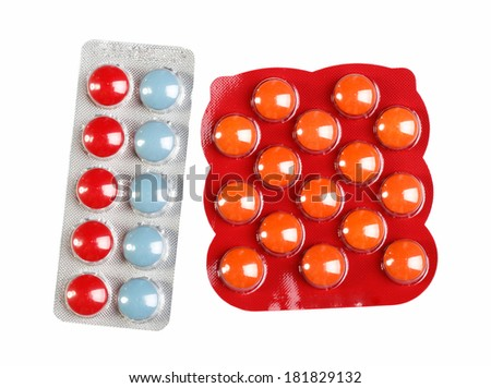 color pills in a blister pack on white