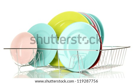 Color plates in rack isolated on white - stock photo