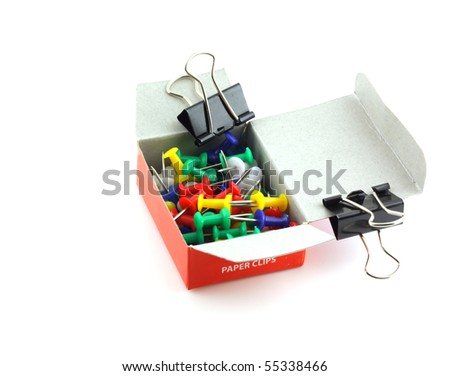 Color power drawing-pins in box and black clips. - stock photo