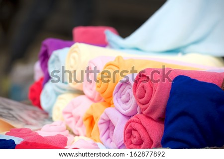 color rolled towels on the street - stock photo