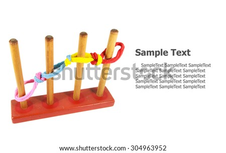 color rubber hair bundle isolated with wooden toy on white background - stock photo