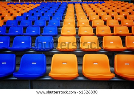 Color seat in football stadium - stock photo