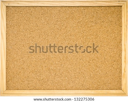 Color shot of a brown cork board in a frame. - stock photo