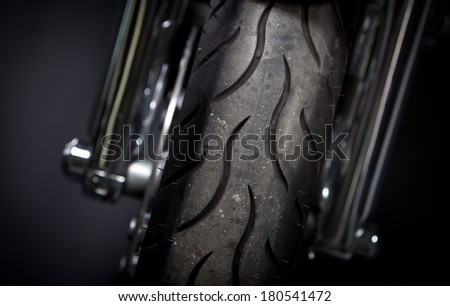 Color shot of a motorcycle forks and tire. - stock photo