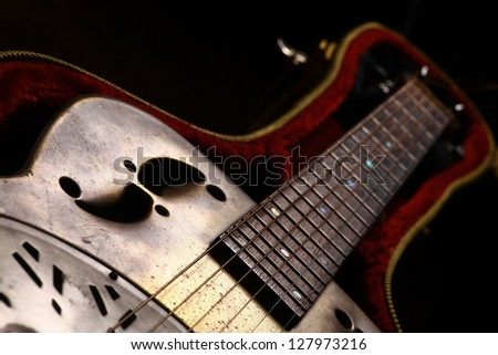 Color shot of a vintage guitar in a case - stock photo
