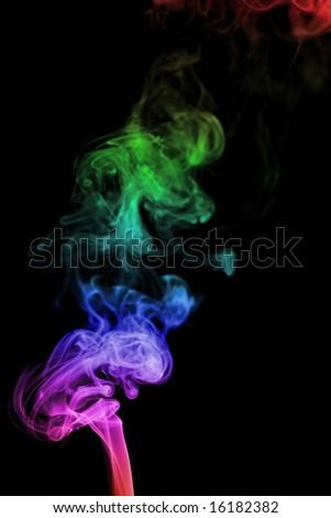 Color smoke on black background - stock photo