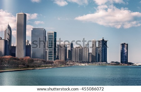 Color snapshot of silhouette of Chicago skyline. Downtown cityscape with skyscrapers. Clear sky daytime on the Michigan lake. Illinois, USA. Vintage tinted. - stock photo