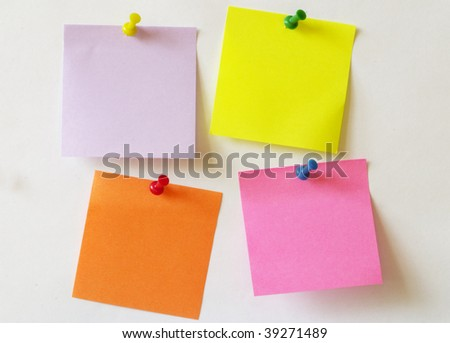 Color sticker notes over white paper background - stock photo