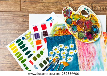 Color studies art school brushes palette and painting - stock photo