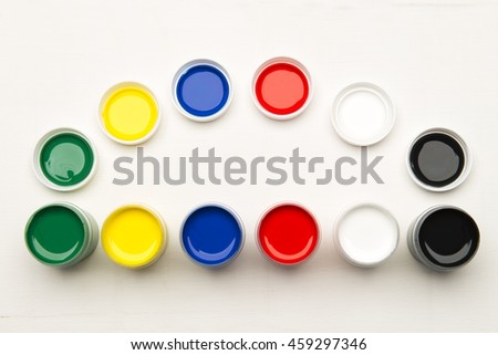 Color tempera water based paints on a white background - stock photo