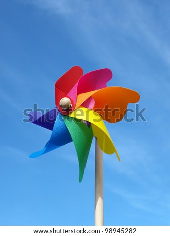 Color windmill toy on the sky background - stock photo