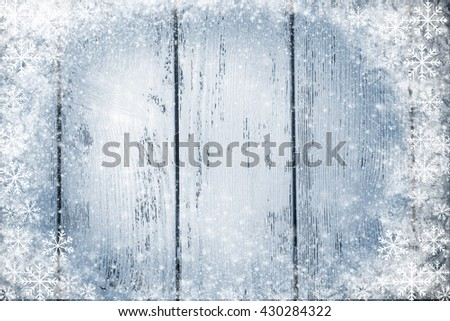 Color wooden background with snow effect - stock photo