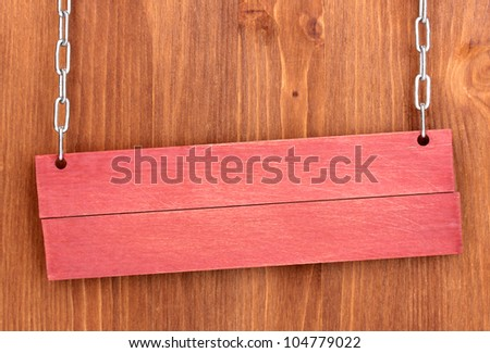 Color wooden sign board on wooden background - stock photo