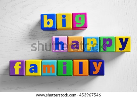 Color words BIG HAPPY FAMILY on light background