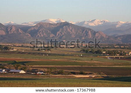 Colorado front range and Boulder FlatIrons  as seen  at sunrise from Broomfield, Colorado  - stock photo