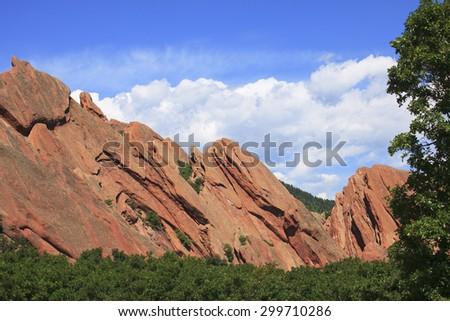 Colorado Red Rocks Scene showing dramatic slant framed by lush vegetation - stock photo