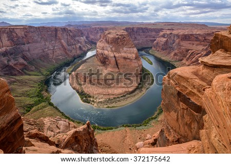 Colorado River at Horseshoe Bend - A cloudy evening at Horseshoe Bend, Page, Arizona, USA. - stock photo