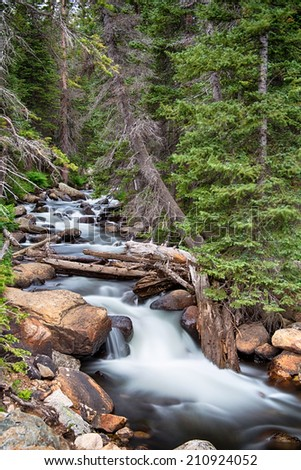 Colorado Rocky Mountain stream with cascading water falls coming down from Longs Lake in the Indian Peaks Wilderness Area, Boulder County Colorado.      - stock photo