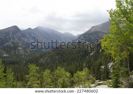 Colorado Rocky Mountains with stormy clouds - stock photo