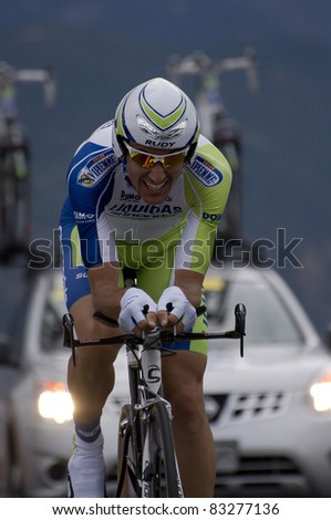 COLORADO SPRINGS, CO - AUG 22: Professional cyclist Ivan Basso of Italy is  riding the prologue course of the 2011 USA Pro Cycling Challenge in Colorado Springs, USA on Aug 22, 2011 - stock photo