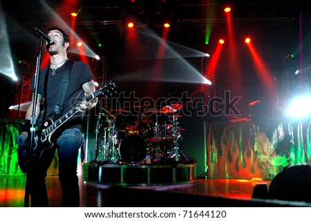 COLORADO SPRINGS, CO. USA - AUGUST 7: Sully Erna Vocalist/Guitarist of the heavy metal band Godsmack performs in concert August 7, 2007 at the City Auditorium in Colorado Springs, CO. USA - stock photo