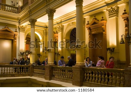 Colorado State Representatives during a break in the Colorado State Capitol. - stock photo