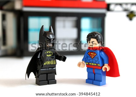 Colorado, USA - March 22, 2015: Studio shot of Lego minifigure Batman and Superman with building in background, image isolated on white. - stock photo