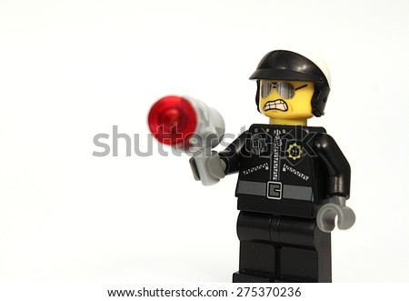Colorado, USA - May 4, 2015: Studio shot of Lego cop with gun. Legos are a popular line of plastic construction toys manufactured by The Lego Group, a company based in Denmark.