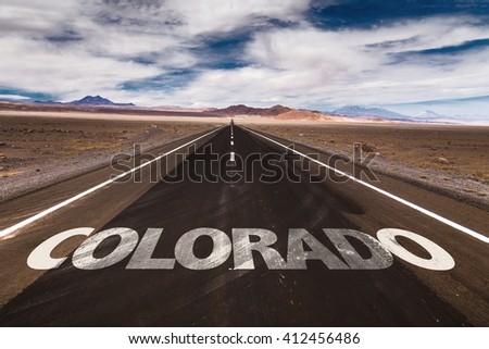 Colorado written on desert road - stock photo