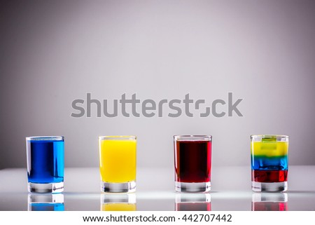 Colored alcoholic shots - stock photo