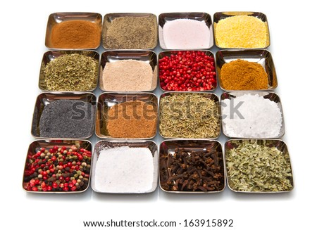 colored and mixed spice in box on white background